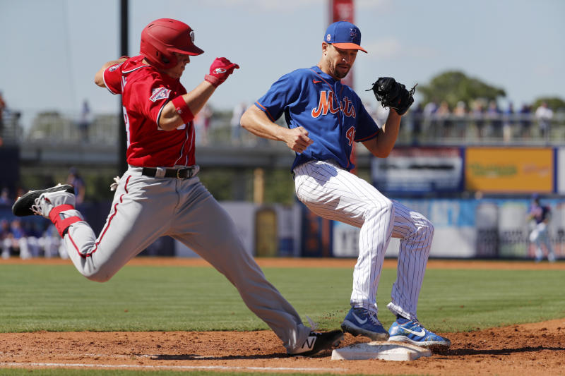 New York Mets pitcher Jacob deGrom, right, forces Washington Nationals' JB Shuck out at first base to end the top of the third inning of a spring training baseball game Sunday, March 1, 2020, in Port St. Lucie, Fla. (AP Photo/Jeff Roberson)