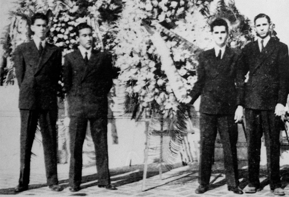 """<p>From Fidel Castro's 1945 High School Yearbook: """"Our floral offering November 27 to slain revolutionary students. Fidel Castro is at the extreme right. (AP Photo/Diario De La Marina) </p>"""