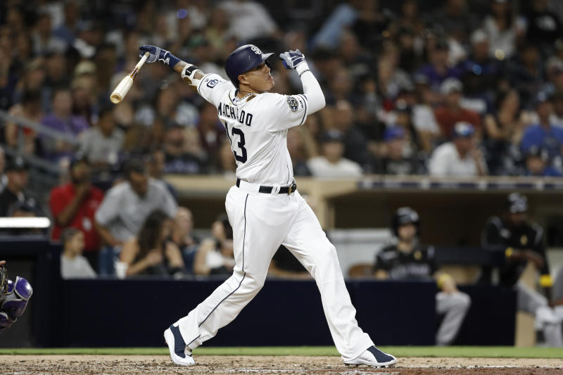 FILE - In this Sept. 7, 2019, file photo, San Diego Padres' Manny Machado watches his two-run home run during the sixth inning of a baseball game against the Colorado Rockies in San Diego. The average salary in the major leagues has dropped in consecutive years for the first time since the players' association started keeping records more than a half-century ago. This year's drop followed two slow free-agent markets and new contracts with large signing bonuses for Machado, Mike Trout, Alex Bregman, Jacob deGrom, Paul Goldschmidt and A.J. Pollock. (AP Photo/Gregory Bull)