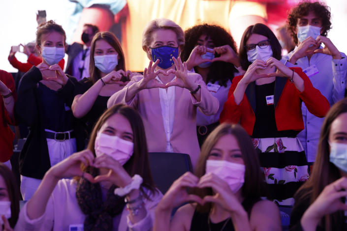 European Commission President Ursula von der Leyen makes a heart Erasmus European program students during Europe Day ceremony and the Future of Europe conference at the European Parliament in Strasbourg, eastern France, Sunday, May 9, 2021. (AP Photo/Jean-Francois Badias, Pool)