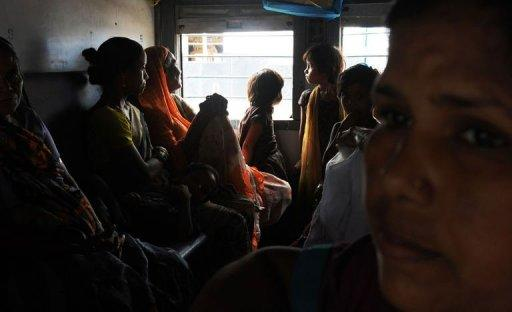 Indian women and children waiting inside a train carriage at a railway station in New Delhi, in July 2012. Deadly floods, power blackouts and traffic gridlock, many of Asia's biggest cities are buckling under the strain of rapid economic development, extreme weather and an exodus from the countryside