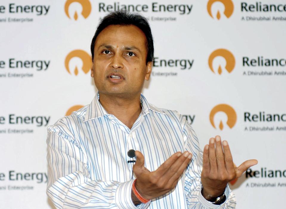 Reliance Energy Chairman Anil Ambani gestures as he announces an Indian Rupees one billion (22,988,505 USD) disaster management plan to focus on safety, reliability, backup and standby of network, in Mumbai 02 August 2005. Ambani assured Reliance Energy's 20,000-odd customers in Kurla, Saki Naka and Kalina, Mumbai's worst flood-hit areas, that they would be provided with power in the next 24 to 48 hours with the replacement of some 90 transformers which broke down during the unprecedented rains in Mumbai last week. AFP PHOTO
