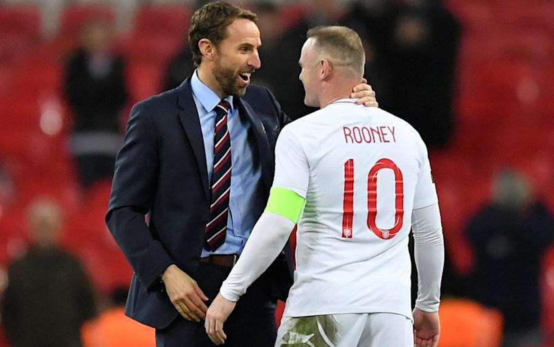 Wayne Rooney bids farewell to his England career with Gareth Southgate after his valedictory appearance against the United States - REUTERS