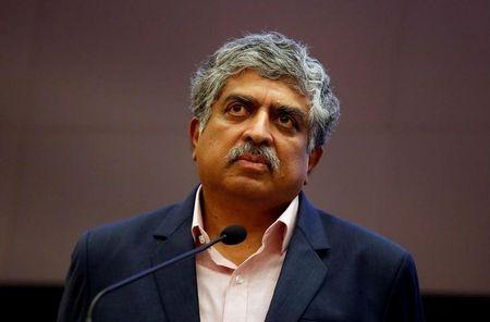 Nandan Nilekani, Co-founder and Non-Executive Chairman of Infosys, listens to reporters' questions during the announcement of the company's quarterly results at its headquarters in Bengaluru, India, January 12, 2018. REUTERS/Abhishek N. Chinnappa