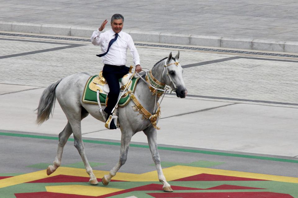 Turkmenistan's President Gurbanguly Berdymukhamedov rides a horse while celebrating the country's 30th independence anniversary in Ashgabat, Turkmenistan, Monday, Sept. 27, 2021. Turkmenistan on Monday marked the 30th anniversary of its independence with a military parade that involved thousands of people. The pomp-filled parade took place in Ashgabat, the capital of the gas-rich former Soviet nation in Central Asia. (AP Photo/Alexander Vershinin)