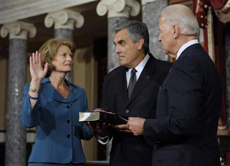 Murkowski, with her husband Martell, takes part in a re-enactment of her swearing-in by Vice President Biden in the Old Senate Chamber at the U.S. Capitol in Washington