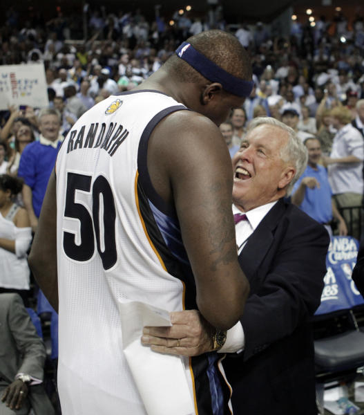 """FILE - In this April 23, 2011 file photol, Memphis Grizzlies owner Michael Heisley, right, congratulates forward Zach Randolph (50) after the Grizzlies defeated the San Antonio Spurs in Game 3 of a first-round NBA basketball series in Memphis, Tenn. Heisley finally may have found a buyer for his NBA team. The majority owner of the Grizzlies told The Commercial Appeal Monday, June 11, 2012, that he has talked with billionaire Robert Pera but there is no contract """"at this point."""" (AP Photo/Lance Murphey, file)"""