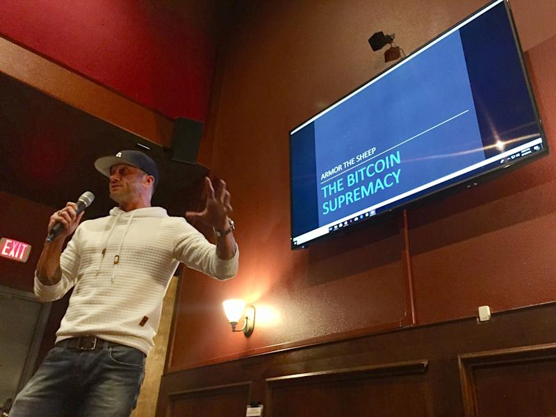 In this Feb. 7, 2018, photo, Jeff Hanzlik delivers a presentation about bitcoin at a bitcoin meet-up group at a restaurant in Hillsboro, Ore. Hanzlik, of Portland, was an early adopter of bitcoin and uses it to make purchases online and in stores. (AP Photos/Gillian Flaccus)