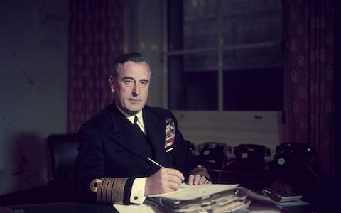 First Sea Lord Louis Mountbatten, Earl Mountbatten, at his office in the Admiralty, in 1955 - Credit: Hulton Royals Collection/Hulton Archive