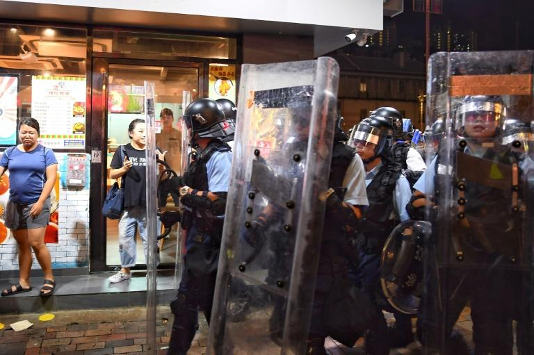 Police officers confront pro-democracy protestors in the Sham Shui Po area of Hong Kong