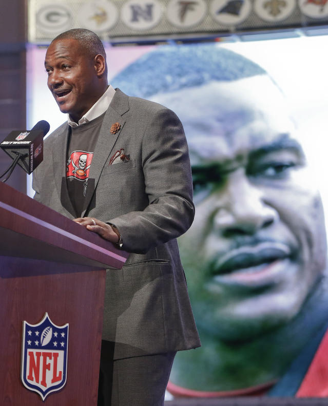Former Tampa Bay Buccaneers linebacker Derrick Brooks announces Washington tight-end Austin Seferian-Jenkins as the 38th pick by the Buccaneers during the second round of the 2014 NFL Draft, Friday, May 9, 2014, in New York. (AP Photo/Jason DeCrow)
