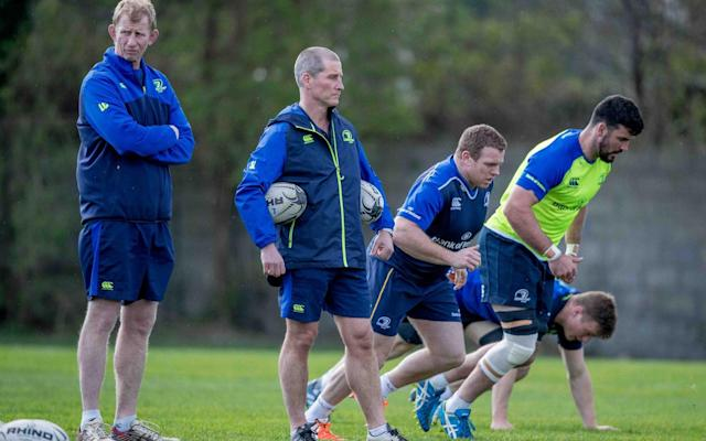 Stuart Lancaster (centre) puts the Leinster players through their paces - Rex Features