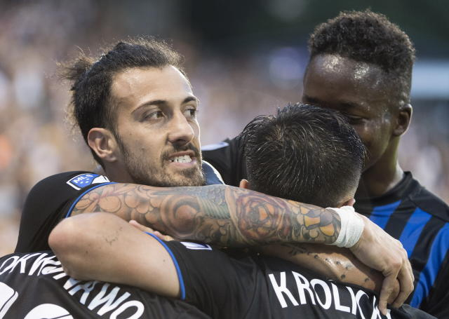 Montreal Impact players celebrate a goal by Orji Okwonkwo against the Portland Timbers during the first half of an MLS soccer game in Montreal, Wednesday, June 26, 2019. (Graham Hughes/The Canadian Press via AP)