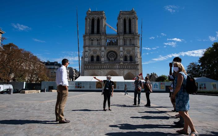 President Macron was due to visit on Thursday to mark the two year anniversary of the blaze - Getty