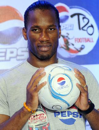 International football player from Ivory Coast, Didier Drogba holds a football during a press conference at a function in New Delhi on June 17, 2012.  Didier Drogba is in the city for the grand finale of the Pepsi T20 football tournament.   AFP PHOTO/ SAJJAD HUSSAIN