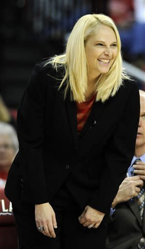 Maryland coach Brenda Frese smiles in the final minutes of Maryland's 88-47 win over Mount St. Mary's in an NCAA college basketball game Friday, Nov. 9, 2012 in College Park, Md. (AP Photo/Gail Burton)