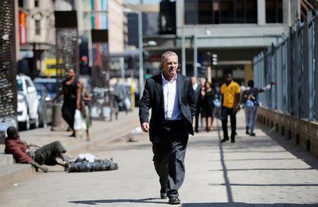 State prosecutor Gerrie Nel arrives for an appeal hearing brought by prosecutors against the six-year jail term handed to Oscar Pistorius for the murder of his girlfriend Reeva Steenkamp in Johannesburg, South Africa August 26, 2016. REUTERS/Siphiwe Sibeko