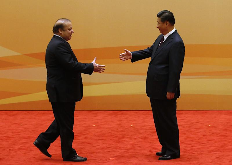 China's President Xi Jinping (R) shakes hands with Pakistan's Prime Minister Nawaz Sharif prior to the Dialogue On Strengthening Connectivity Partnership in Beijing on November 8, 2014