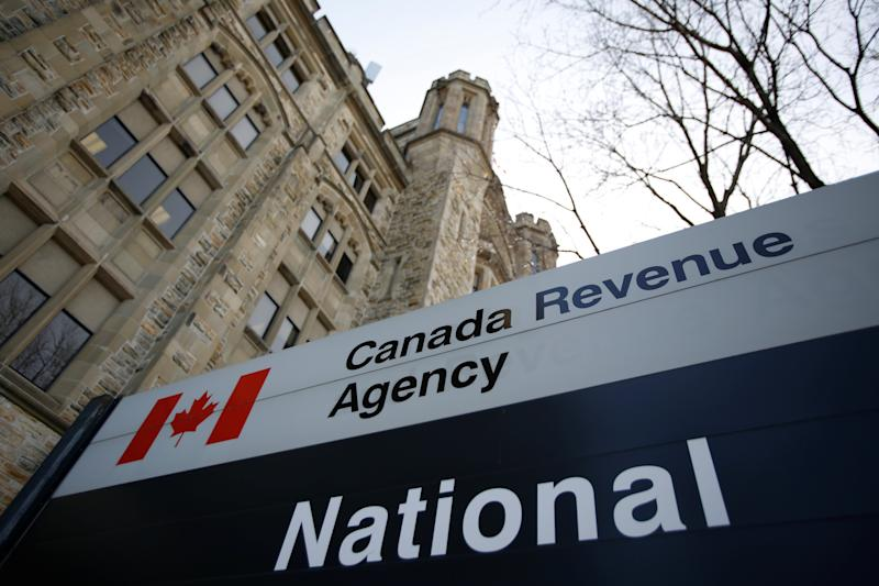 A sign is pictured in front of the Canada Revenue Agency (CRA) national headquarters in Ottawa, Ontario, Canada March 13, 2017. REUTERS/Chris Wattie