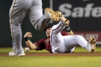 Arizona Diamondbacks second baseman Josh VanMeter, right, can't make a play on a base hit by Milwaukee Brewers' Jace Peterson as Kolten Wong advances to second during the sixth inning of a baseball game, Wednesday, June 23, 2021, in Phoenix. (AP Photo/Matt York)