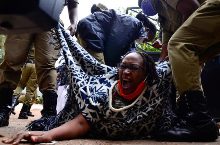 Ugandan academic Stella Nyanzi reacts as police officers detain her for protesting against the way that government distributes the relief food and the lockdown situation to control the spread of the coronavirus disease (COVID-19) outbreak in Kampala