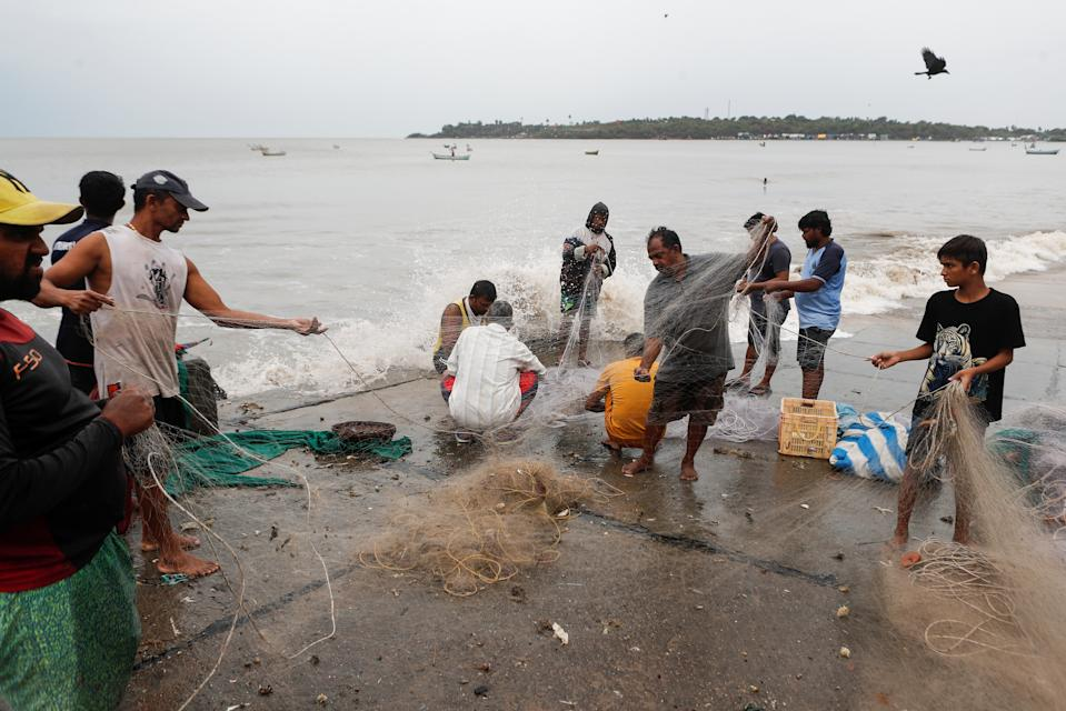 Fishermen gather their nets by the sea shore to store them before cyclone Nisarga makes its landfall, in Mumbai, India June 3, 2020. REUTERS/Francis Mascarenhas