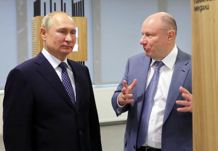 FILE - In this file pool photo taken on Tuesday, Dec. 3, 2019, Vladimir Potanin, the billionaire owner of a nickel giant, right, gestures while speaking to Russian President Vladimir Putin in Sochi, Russia. During Friday's call with officials and environmental experts, Putin lashed out at Vladimir Potanin, whose Norilsk Nickel company owns the power plant, saying that it was his company's responsibility to check the fuel tanks' condition. (Mikhail Klimentyev, Sputnik, Kremlin Pool Photo via AP, File)