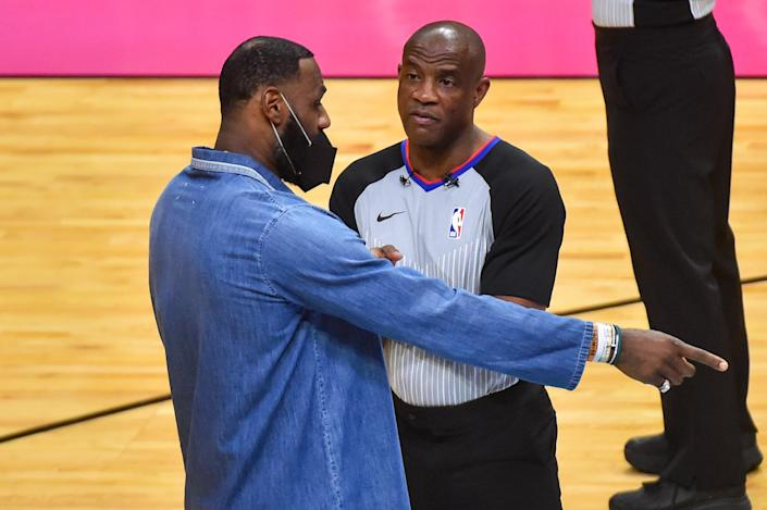 Official Tony Brown with LeBron James.