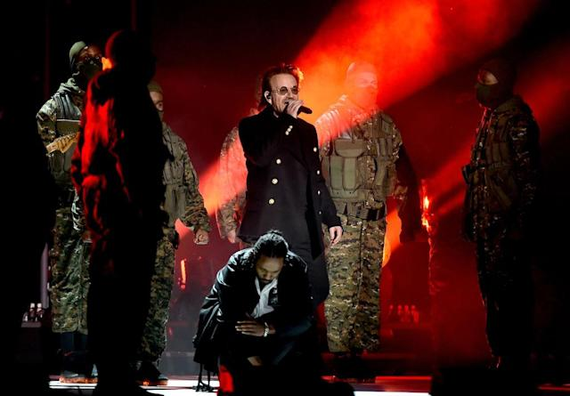 <p>Bono of U2 (holding microphone) and Kendrick Lamar perform onstage during the 60th Annual Grammy Awards on January 28, 2018, at Madison Square Garden in New York City. (Photo: Getty Images) </p>