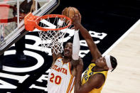 Indiana Pacers center Myles Turner (33) blocks a shot by Atlanta Hawks forward John Collins (20) during the second quarter of an NBA basketball game Saturday, Feb. 13, 2021, in Atlanta. (AP Photo/Butch Dill)
