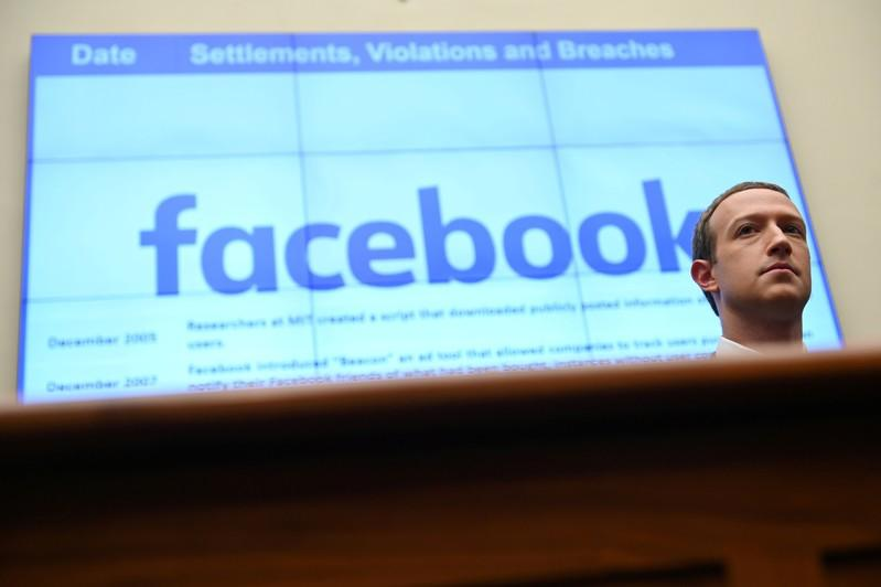 FILE PHOTO: Facebook Chairman and CEO Zuckerberg testifies at a House Financial Services Committee hearing in Washington