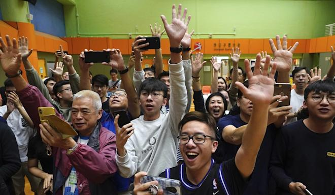 Jubilation as another pro-democracy politician wins in the district council elections. Photo: AP