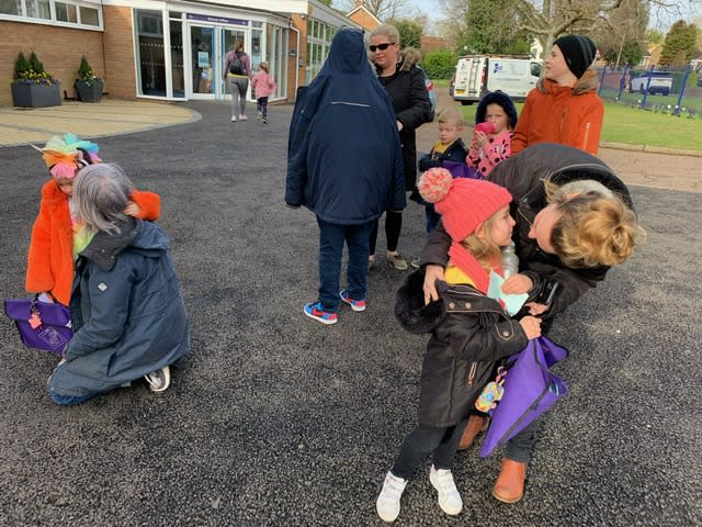 Parents were asked to keep a safe distance as they dropped off children for their last day at school