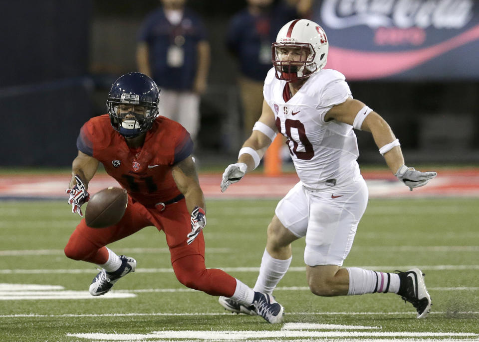 Arizona wide receiver Nate Phillips tries to make the catch in front of Stanford safety Zach Hoffpauir (10) during the first half of an NCAA college football game, Saturday, Oct. 29, 2016, in Tucson, Ariz. The pass was incomplete. (AP Photo/Rick Scuteri)
