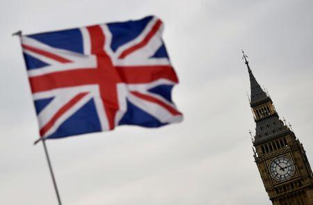 The Union flag flies infront of the Big Ben clock tower in London