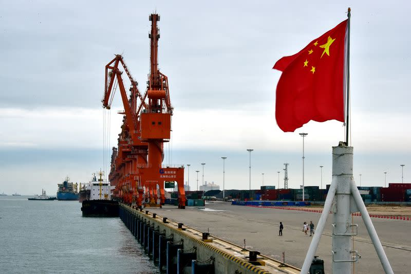 A Chinese national flag is seen at a port in Beihai