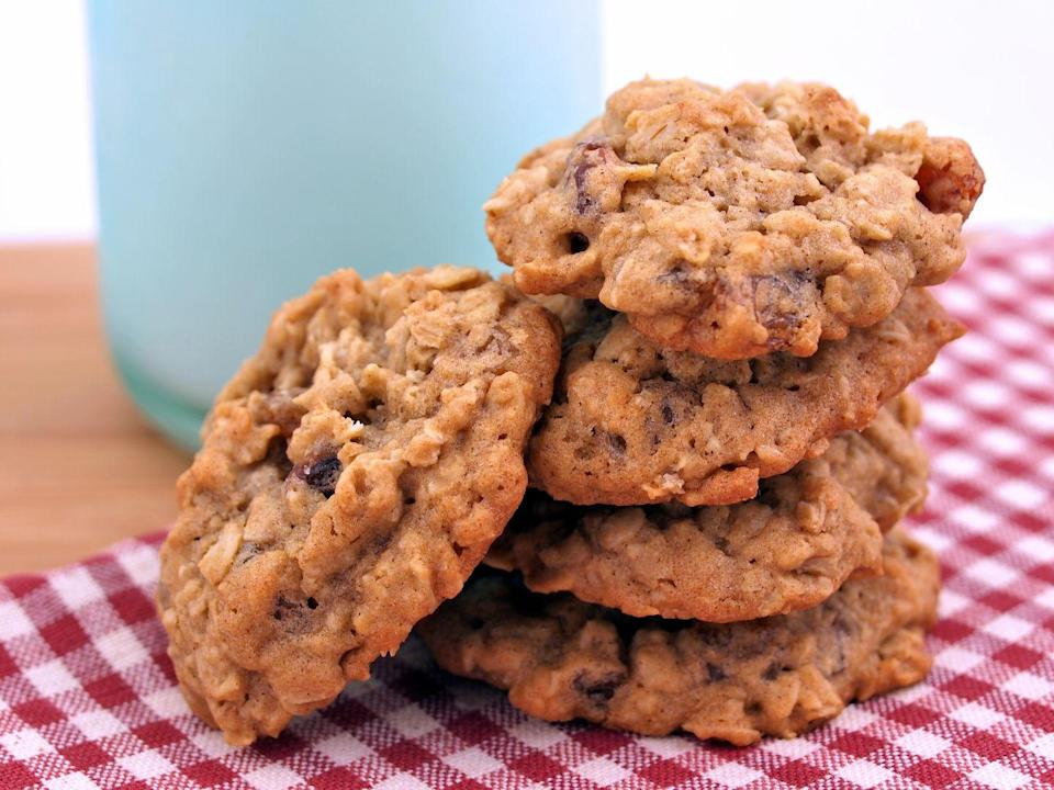 """<p>Need a cookie, like, now? Whip up a batch of easy oatmeal cookies to satisfy your craving in a super healthy way. """"I would recommend making homemade oatmeal cookies using raw oats, and nuts,"""" Jamie Hickey, certified personal trainer and nutritionist, and founder of <a href=""""https://truismfitness.com/"""" rel=""""nofollow noopener"""" target=""""_blank"""" data-ylk=""""slk:Truism Fitness"""" class=""""link rapid-noclick-resp"""">Truism Fitness</a>, tells Delish. This gives you a snack high in fiber, protein, and healthy fats. And, you know, it's really good. </p>"""