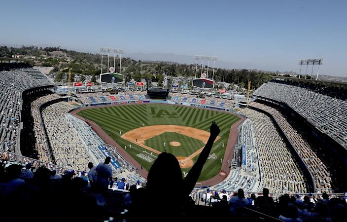 Socially distanced fans attend the Dodgers' season home opener April 9, 2021.