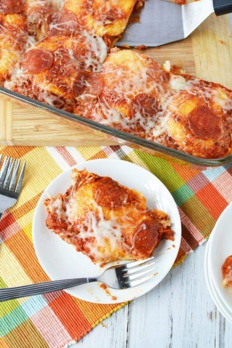 """<p>You really can't go wrong with pizza for dinner. However, this dish is even better because it only takes 10 minutes to put together.</p><p><strong>Get the recipe at <a href=""""https://perfectionpending.net/easy-10-minute-kid-friendly-pizza-bake/"""" rel=""""nofollow noopener"""" target=""""_blank"""" data-ylk=""""slk:Perfection Pending"""" class=""""link rapid-noclick-resp"""">Perfection Pending</a>.</strong></p><p><strong><strong><a class=""""link rapid-noclick-resp"""" href=""""https://www.amazon.com/Rachael-Ray-Nonstick-Bakeware-Rectangle/dp/B002CXIL1I/?tag=syn-yahoo-20&ascsubtag=%5Bartid%7C10050.g.4772%5Bsrc%7Cyahoo-us"""" rel=""""nofollow noopener"""" target=""""_blank"""" data-ylk=""""slk:SHOP BAKING PANS"""">SHOP BAKING PANS</a></strong><br></strong></p>"""