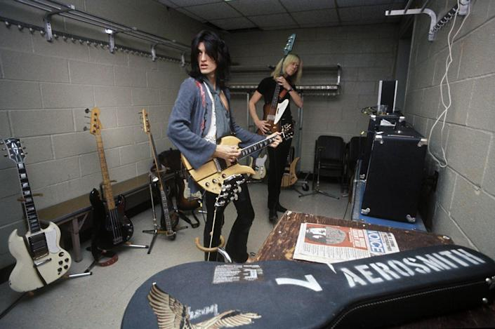 <p>Aerosmith's Tom Hamilton and Joe Perry warm up backstage at Madison Square Garden before a concert in 1976. </p>