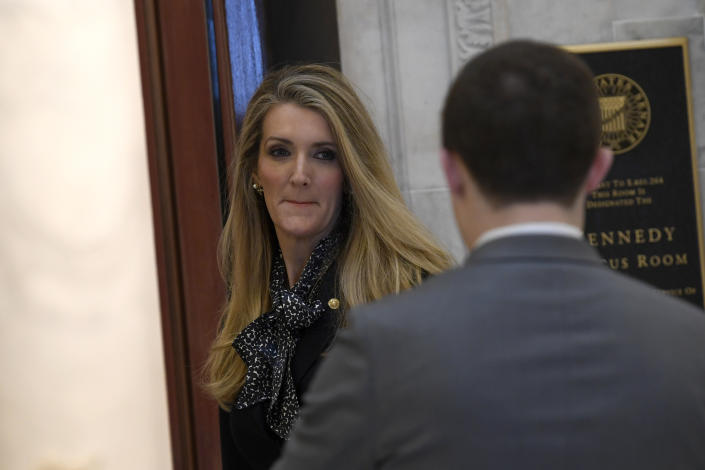 Sen. Kelly Loeffler, R-Ga., arrives for a Republican policy lunch on Capitol Hill in Washington, Friday, March 20, 2020, to work on a sweeping economic rescue plan amid the pandemic crisis and nationwide shutdown that's hurtling the country toward a likely recession. (AP Photo/Susan Walsh)