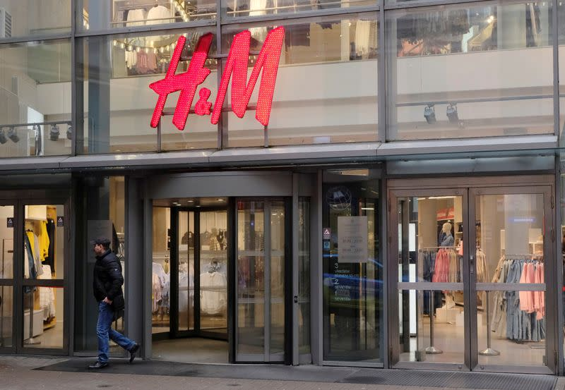 A man leaves H&M shop in Riga