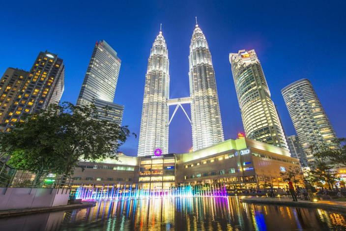 """<p><strong>Location:</strong> Kuala Lumpur, Malaysia</p><p><strong>Height:</strong> 1,483 feet (each)</p><p><strong>Completion Date:</strong> 1998</p><p>A two-story skybridge connects these twin towers at the 41st and 42nd floors. It not only gives the structure its iconic look, but it also """"speaks to the future of tall buildings"""" and urban development, Safarik says. That future will involve connecting tall buildings at height, he argues, so that people in large buildings can cross from one to another without going all the way down to the ground and up again. Few but the Petronas towers have that feature today.</p><p><em><strong>Honorable mention:</strong> The Changsha IFS Tower T1 in Changsha, China is also 1,483 feet tall. The taller twin tower of the Changsha IFS complex meant to attract high-end financial institutions offers visitors to China a Wong Tung & Partners design featuring a rectangle form with glass and metal. The Tower 1 design includes incremental setbacks near the top to help match the shorter second tower without dwarfing its existence. At 94 floors, expect a mix of uses within the building.</em></p>"""