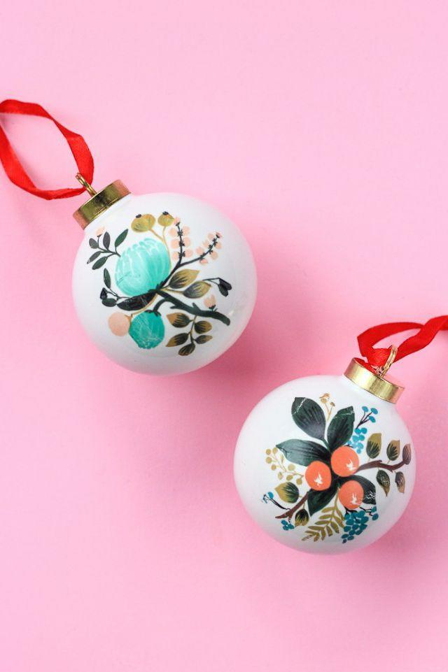 """<p>There's a reason these beauties look so perfect! This blogger used temporary tattoos to transfer these elegant floral designs on to plain baubles.</p><p><strong>Get the tutorial at <a href=""""https://thecraftedlife.com/temporary-tattoo-ornaments/"""" rel=""""nofollow noopener"""" target=""""_blank"""" data-ylk=""""slk:The Crafted Life"""" class=""""link rapid-noclick-resp"""">The Crafted Life</a>.</strong></p><p><a class=""""link rapid-noclick-resp"""" href=""""https://www.amazon.com/Konsait-Temporary-Waterproof-Butterfly-Blossoms/dp/B07T42HS7W/ref=sr_1_7?tag=syn-yahoo-20&ascsubtag=%5Bartid%7C10050.g.1070%5Bsrc%7Cyahoo-us"""" rel=""""nofollow noopener"""" target=""""_blank"""" data-ylk=""""slk:SHOP TEMPORARY TATTOOS"""">SHOP TEMPORARY TATTOOS</a></p>"""