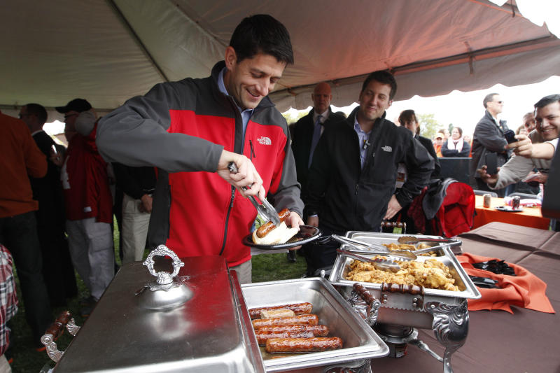 Republican vice presidential candidate, Rep. Paul Ryan, R-Wis., puts food on his plate at a Bowling Green State University and Miami University of Ohio football game tailgate party, Saturday, Oct. 13, 2012 in Bowling Green, Ohio. (AP Photo/Mary Altaffer)