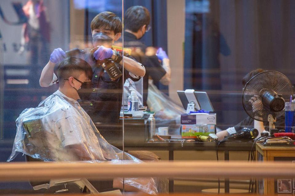 A man gets a haircut at a shopping mall in Kuala Lumpur during Phase Two of the National Recovery Plan on September 10, 2021. — Picture by Shafwan Zaidon