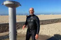 Richard Beach, 69, of Huntington Beach, Calif., said he was told to leave the ocean by lifeguards after he returned to the waves to bodyboard in Huntington Beach, Calif., Sunday, Oct. 10, 2021. The water has been closed to surfing and swimming for a week since an offshore oil pipeline leaked crude into the water off the coast of Orange County. (AP Photo/Amy Taxin)