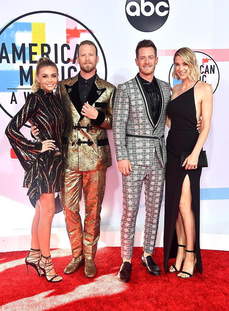 <p>Brittney Marie Cole, Brian Kelley, Tyler Hubbard, and Hayley Stommel attend the 2018 American Music Awards at Microsoft Theater on Oct. 9, 2018, in Los Angeles. (Photo: Frazer Harrison/Getty Images) </p>