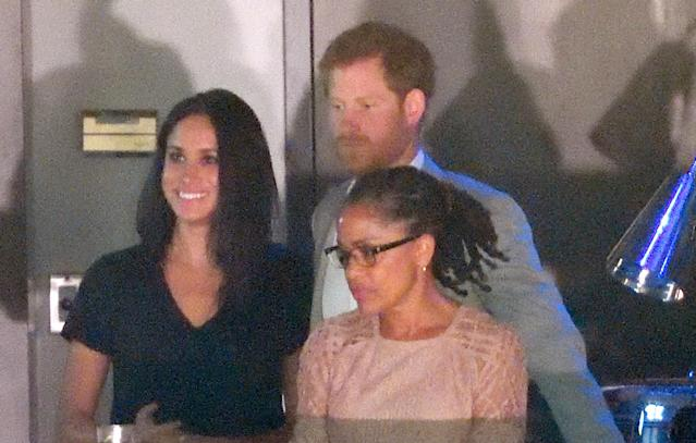<p>The Prince and Markle made another appearance at the Invictus Games alongside Markle's mother Doria. The trio sat in the royal box at the closing ceremony with Harry giving his girlfriend a kiss on the cheek. (Photo: Getty Images) </p>