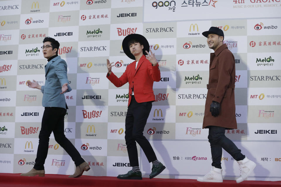 "FILE - In this Jan. 28, 2015, file photo, South Korean K-Pop group Epik High members arrive to attend the K-POP Awards 2014 in Seoul, South Korea. Popular South Korean hip-hop trio Epik High was working on a song called ""End of the World"" before the pandemic hit in 2020. Now, the band's frontman Tablo says, ""I wish that this song is not relevant."" (AP Photo/Ahn Young-joon, File)"